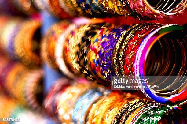 various colorful bangles for sale at market stall - バングル ストックフォトと画像