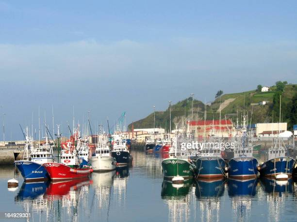 Various colorful fishing boats in one part of harbour in Bermeo. It is a town in the province of Biscay. Sightseeing tour in Bermeo the most...