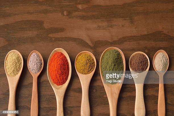 various colorful spices on wooden spoons - spice stock pictures, royalty-free photos & images