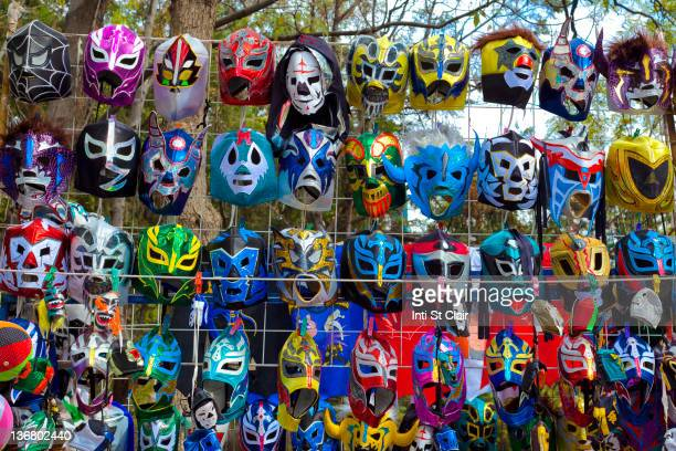 various colorful wrestling masks - mixed wrestling stock pictures, royalty-free photos & images