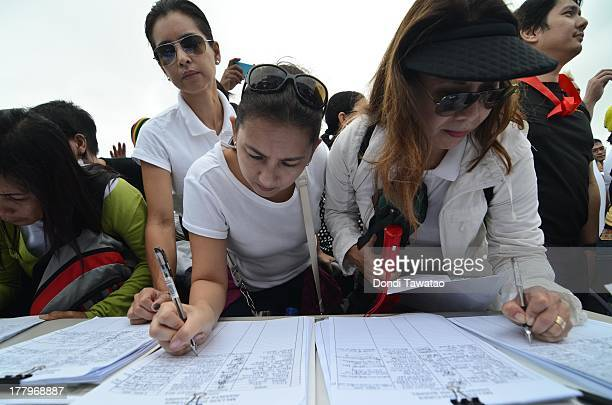 Various concerned citizens sign a petition calling for the abolition of the 'pork barrel' during a protest against the misuse of Philippine state...