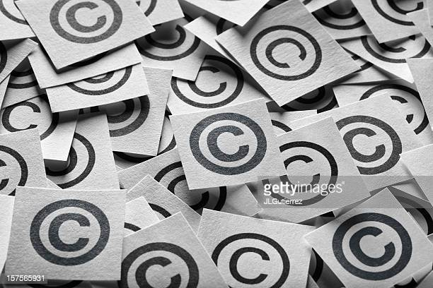 various copyright sign on a square paper - copyright stock photos and pictures
