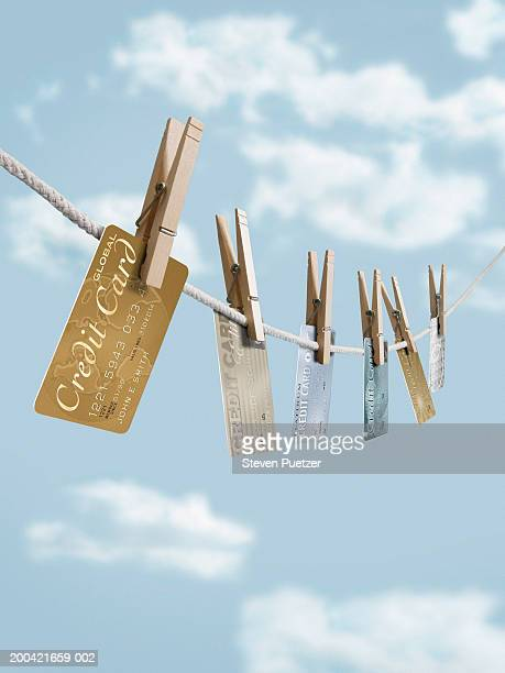 Various credit cards hanging on clothesline