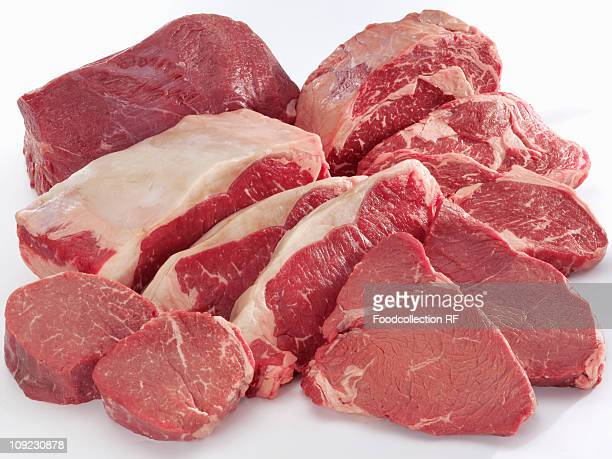 Various cuts of beef on white background, close-up