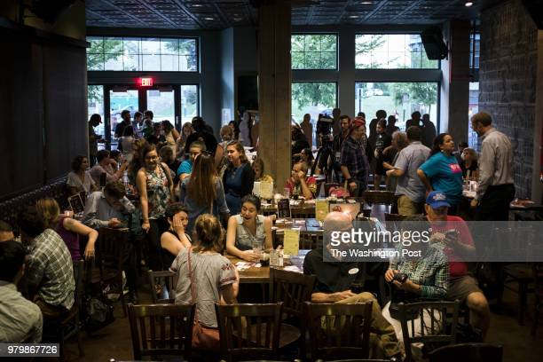 Various DC progressive groups gather for an election night watch party for primary returns on Initiative 77 among other ballot measures at Busboys...