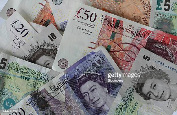 Various denominations of pound notes are seen in this arranged photograph in London UK on Thursday May 17 2012 UK Prime Minister David Cameron plans...