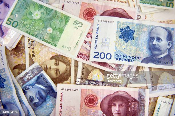 Various denominations of the krone Norwegian bank notes are seen displayed for a photograph at a Forex currency exchange center in Oslo Norway on...