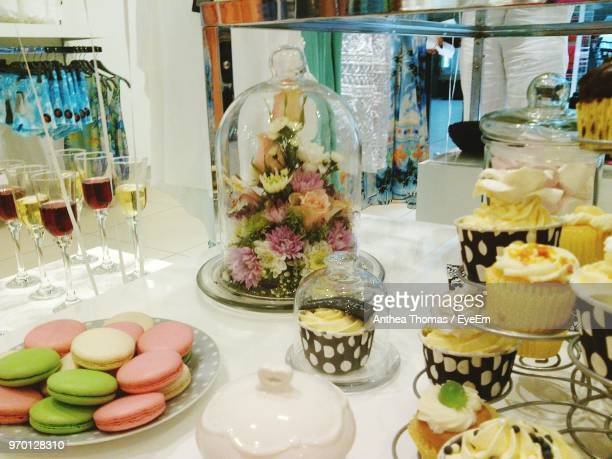 Various Desserts By Flowers On Table