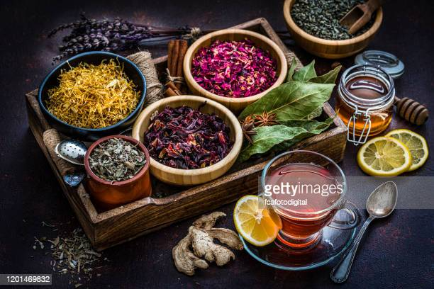 various dried tea leaves and flowers shot from above - tea stock pictures, royalty-free photos & images