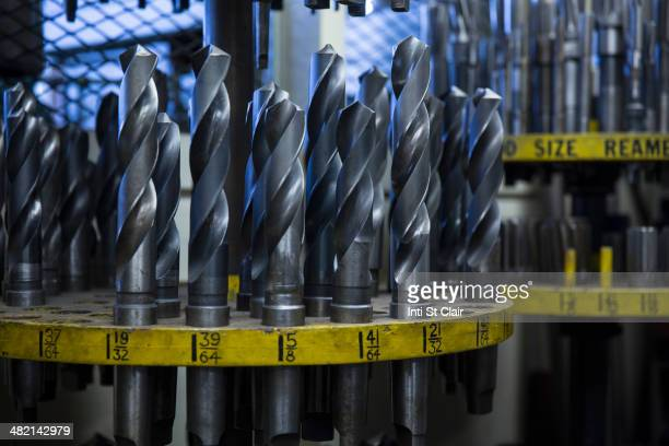 various drill bits in metal shop - drill bit stock photos and pictures