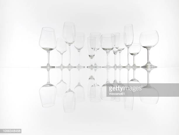 various empty glasses in a row - glas serviesgoed stockfoto's en -beelden