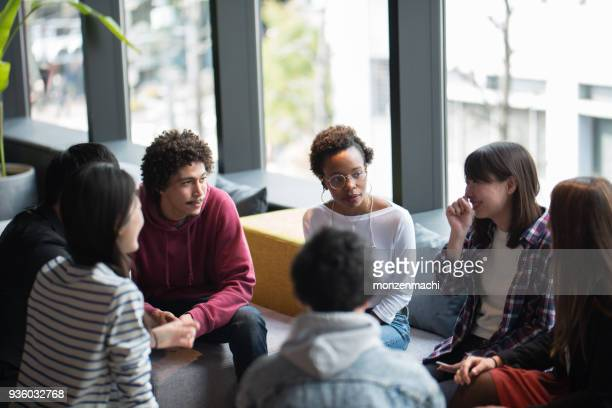 various ethnic people working together in co-working space - multiculturalism stock pictures, royalty-free photos & images
