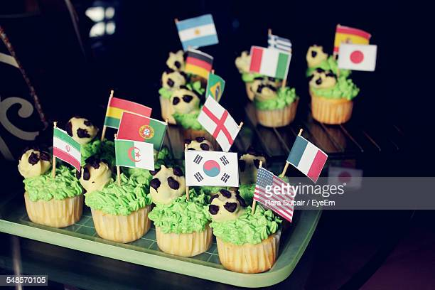 Various Flags On Cupcakes In Tray