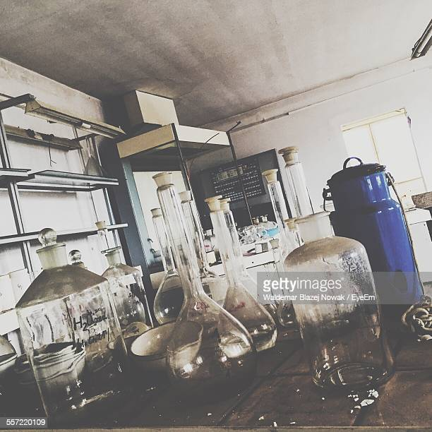 Various Flasks On Table In Laboratory