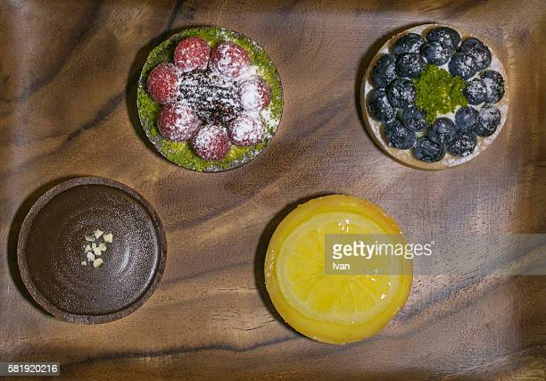 Various Flavors of Fresh Mini Pie Put On a Wood table