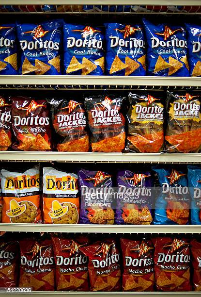 Various flavors of PepsiCo Inc Doritos brand snack chips sit on display in a supermarket in Princeton Illinois US on Friday Oct 12 2012 PepsiCo Inc...