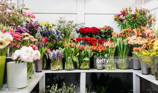 various flowers on display in florist - bouquet stock pictures, royalty-free photos & images