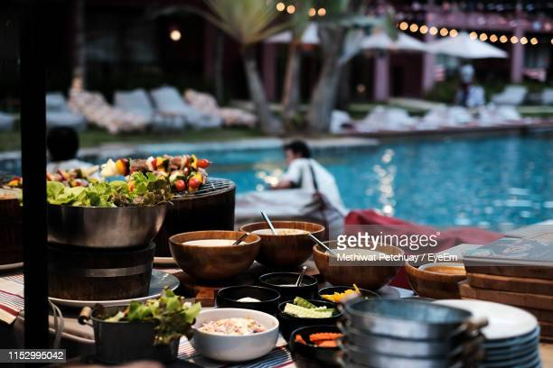 various food on table against swimming pool - hua hin thailand stock pictures, royalty-free photos & images