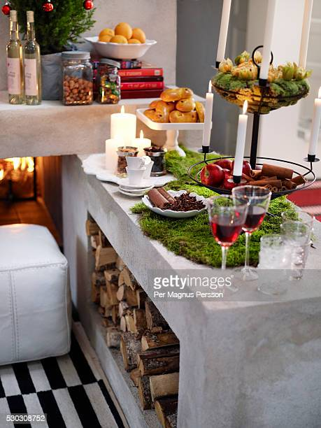 Various food with wine on fireplace