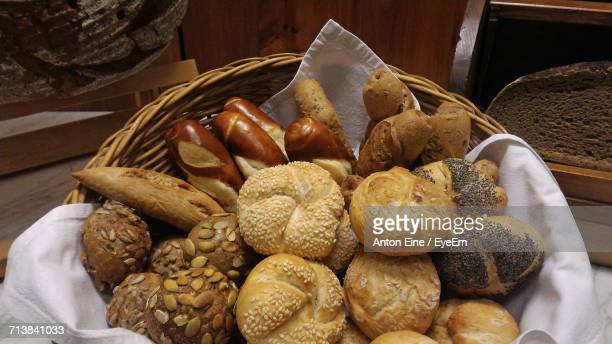 Various Fresh Bun And Loafs Of Bread In Wicker Basket