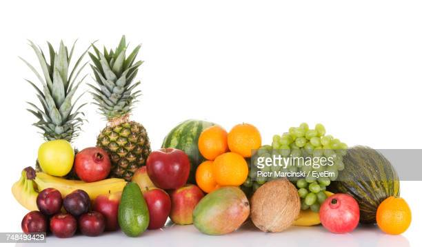 Various Fresh Fruits Against White Background