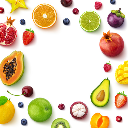 Various fruits and berries isolated on white background, top view, creative flat layout, round frame of fruits with empty space for text 1143911053