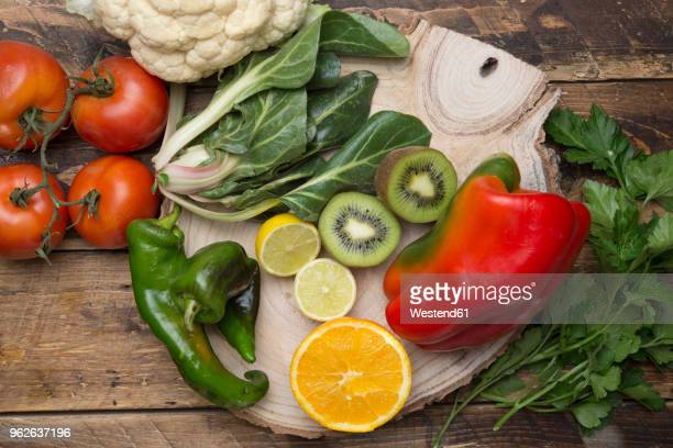 Various fruits and vegetables with vitamin c on wood