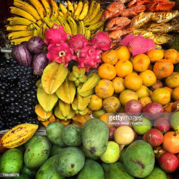 various fruits for sale at market stall - tropische frucht stock-fotos und bilder