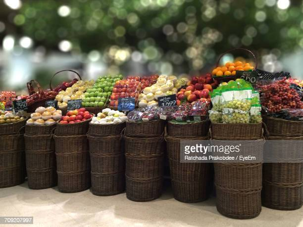 Various Fruits In Wicker Baskets For Sale At Market