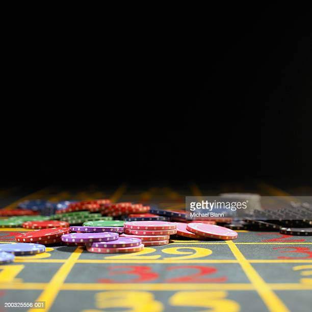 Various gambling chips on roulette table
