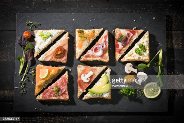 Various garnished sandwiches