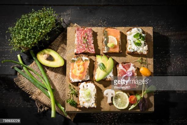 Various garnished sandwiches