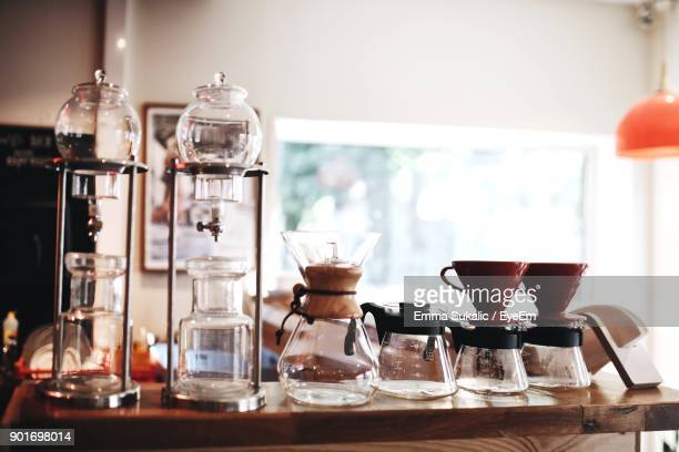 Various Glass Containers On Table At Home