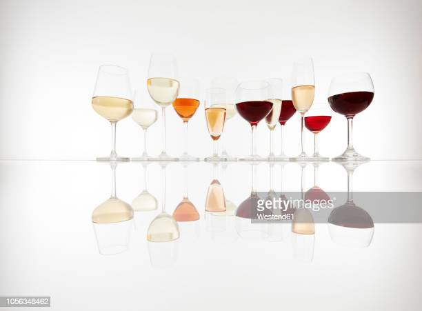 various glasses with wine, prosecco and champagne - copa de vino fotografías e imágenes de stock