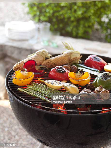 Various grilled vegetables on a barbecue.