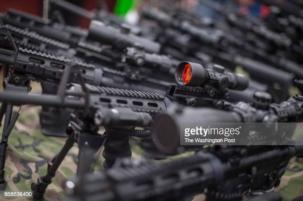 Various guns sit for sale as thousands of customers and hundreds of dealers sell show and buy guns and other items during The Nation's Gun Show at...