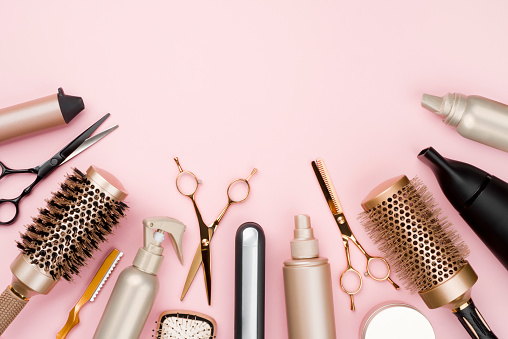 Various hair dresser tools on pink background with copy space 1024577404