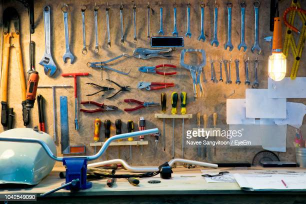 various hand tools hanging on pegboard in workshop - work tool stock pictures, royalty-free photos & images
