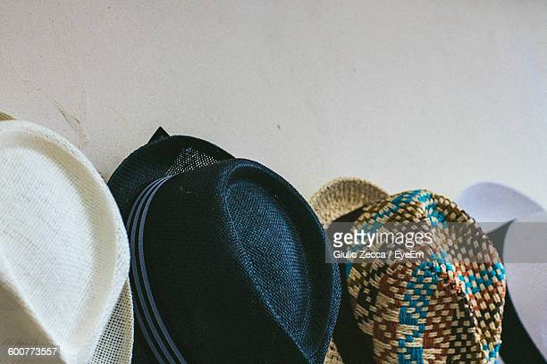 Various Hats Against Wall For Sale At Market Stall