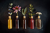 Various herbal oils with flowers