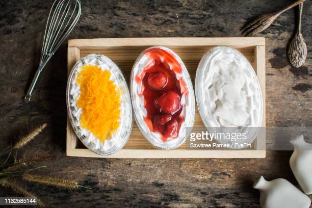 various ice cream in bowls on table - serving size stock pictures, royalty-free photos & images