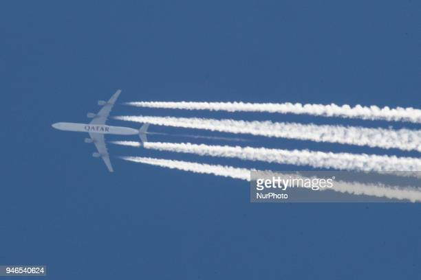 Various images of airplanes overflying Thessaloniki Greece between 3000040000 feet against the blue sky in April 2018 There are planes with the logo...