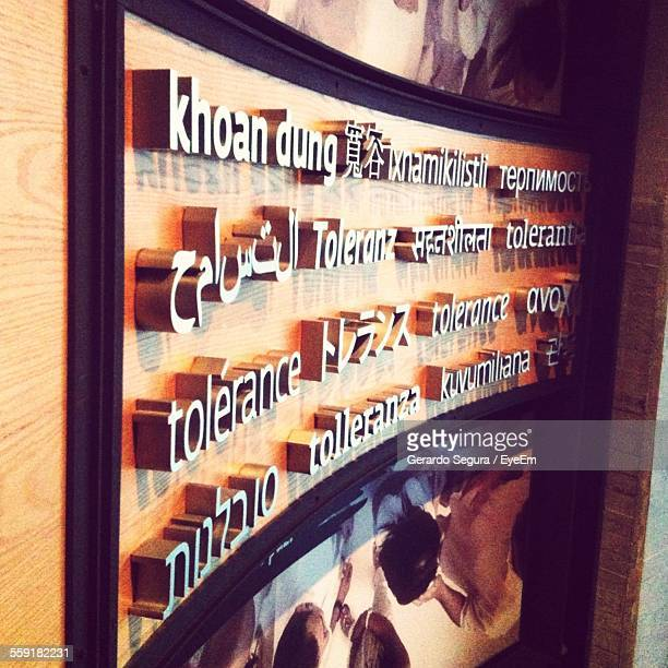 Various Information Sign Board On Wooden Wall