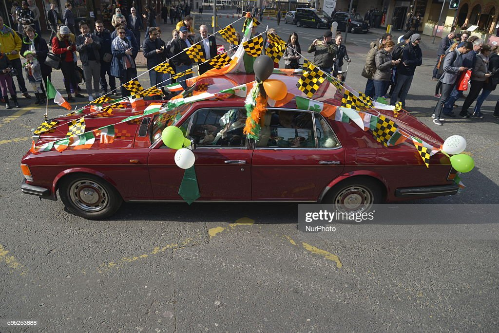 Various Items Of An Irish Theme Decorating A Car Which Is In The