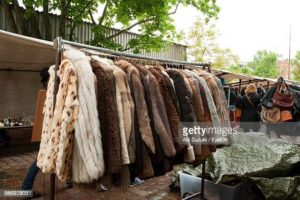 Various Jackets Hanging At Street Market Stall