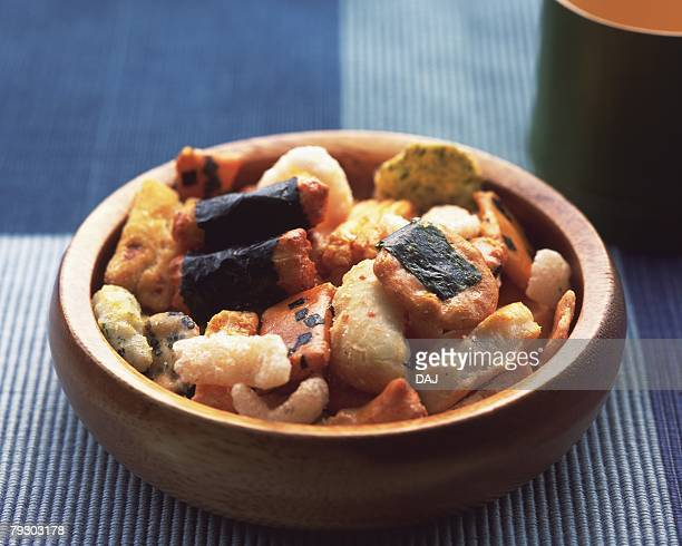 Various Japanese rice crackers in bowl, high angle view, differential focus