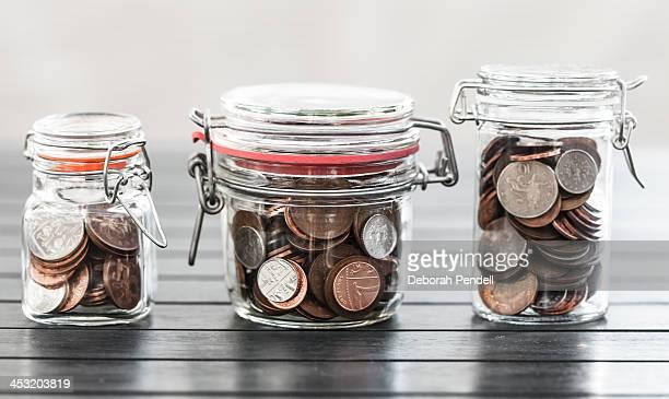 Various jars of money
