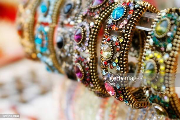 Various jeweled bracelets on display