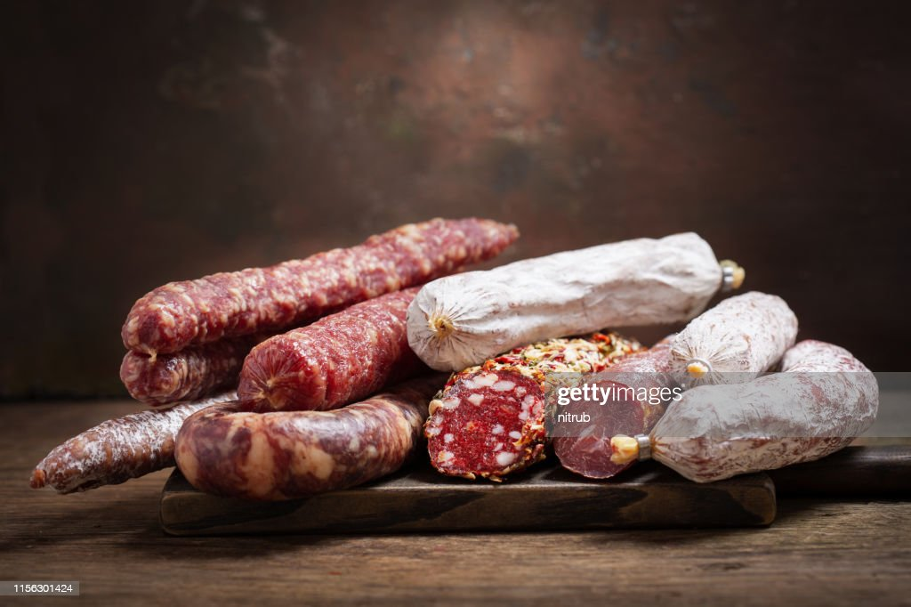 Various kind types of salami and sausages : Stock Photo