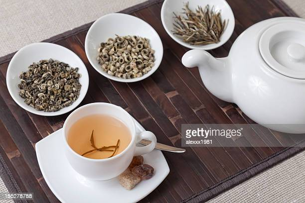 Various kinds of tea with cup and teapot